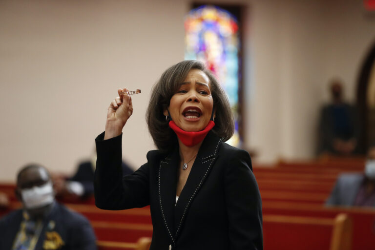 Rep. Lisa Blunt Rochester speaks with Democratic presidential candidate, former Vice President Joe Biden, members of the clergy and community leaders at Bethel AME Church in Wilmington, Del., Monday, June 1, 2020. (AP Photo/Andrew Harnik)