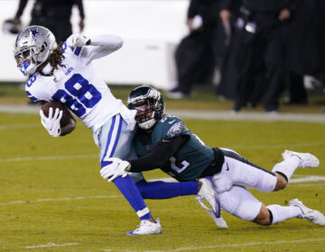Dallas Cowboys' CeeDee Lamb (88) tries to get past Philadelphia Eagles' Marcus Epps (22) during the second half of an NFL football game, Sunday, Nov. 1, 2020, in Philadelphia. (AP Photo/Chris Szagola)