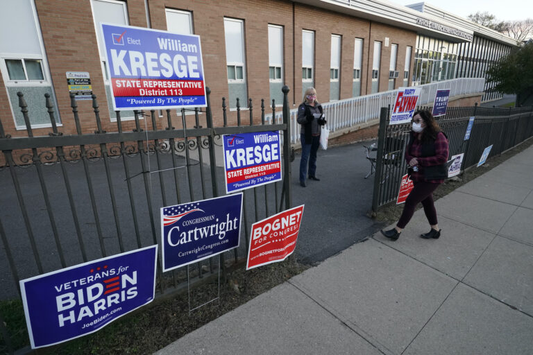 A voter arrives to cast her ballot at the Charles Sumner Elementary School on Election Day, Tuesday, Nov. 3, 2020, in Scranton, Pa. (AP Photo/Mary Altaffer)