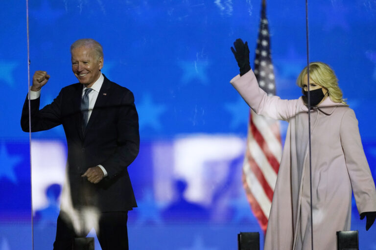 Democratic presidential candidate former Vice President Joe Biden and his wife Jill Biden wave to supporters, Tuesday, Nov. 3, 2020, in Wilmington, Del. (AP Photo/Andrew Harnik)