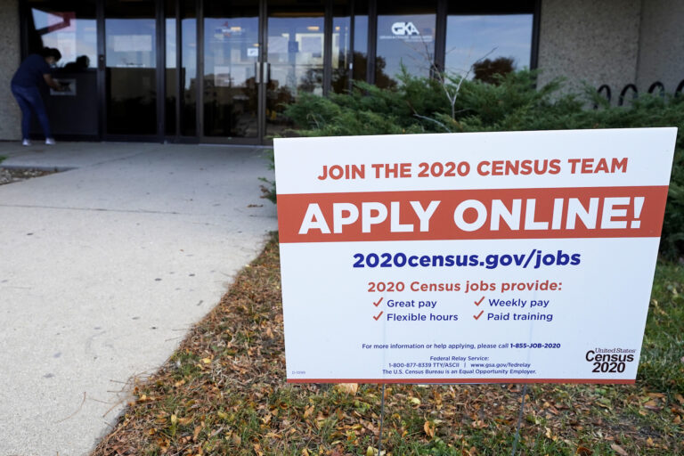 A sign is seen outside of IDES (Illinois Department of Employment Security) WorkNet center in Arlington Heights, Ill., Thursday, Nov. 5, 2020. Illinois reports biggest spike in unemployment claims of all states. (AP Photo/Nam Y. Huh)