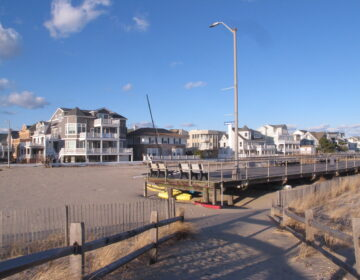 FILE -  This Jan. 16, 2020 file photo shows the end of the Ventnor, N.J. boardwalk as seen from Margate, N.J., where a group of residents want the city to build its own boardwalk. Voters rejected the proposal on Nov. 3.  (AP Photo/Wayne Parry, File)