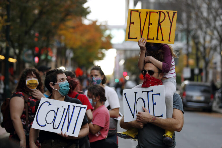 People urge for all votes to be counted during a demonstration outside the Pennsylvania Convention Center where votes are being counted, Thursday, Nov. 5, 2020, in Philadelphia, following Tuesday's election. (AP Photo/Rebecca Blackwell)
