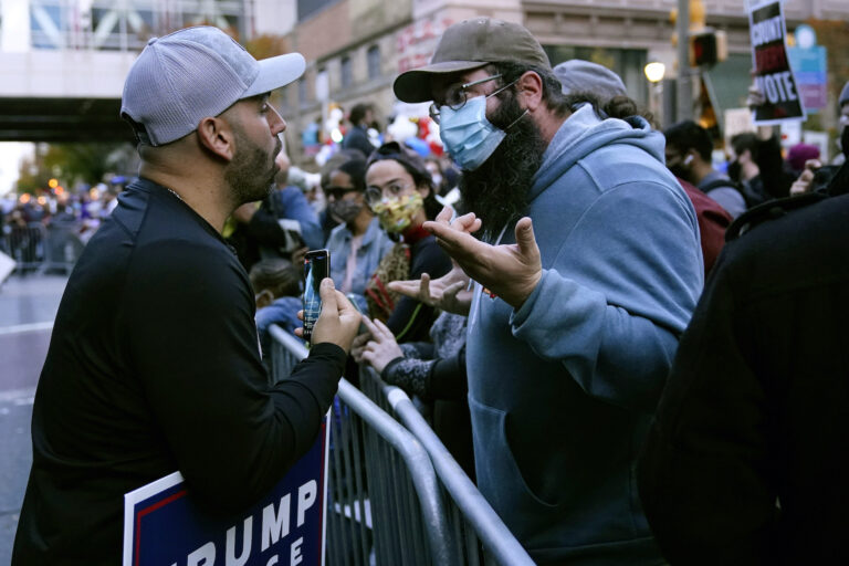 Protesters exchange points of view outside the Pennsylvania Convention Center where votes were being counted, Thursday, Nov. 5, 2020, in Philadelphia, following the Nov. 3 election. (AP Photo/Matt Slocum)