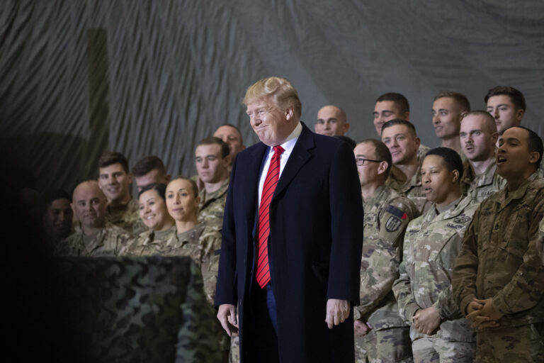 FILE - In this Nov. 28, 2019, file photo President Donald Trump smiles before addressing members of the military during a surprise Thanksgiving Day visit at Bagram Air Field, Afghanistan. (AP Photo/Alex Brandon, File)