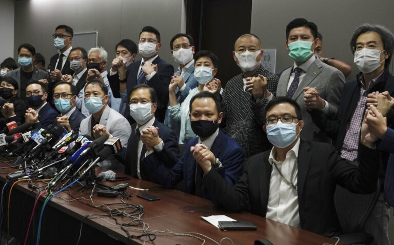 Hong Kong's pro-democracy legislators pose a picture before a press conference at Legislative Council in Hong Kong, Wednesday, Nov. 11, 2020.  Hong Kong's pro-democracy lawmakers announced that they are resigning en masse following a move by the city's government to disqualify four pro-democracy legislators. (AP Photo/Vincent Yu)