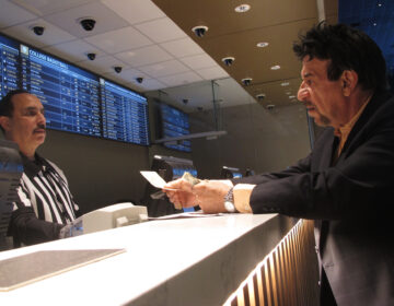 A gambler makes a sports bet at Bally's casino in Atlantic City, N.J. on Jan. 29, 2020. On Nov. 13, 2020, New Jersey gambling regulators released figures showing that the state's red-hot sports betting market had set a new national record for the most money wagered on sports for the third month in a row, taking in over $803 million worth of bets. (AP Photo/Wayne Parry)