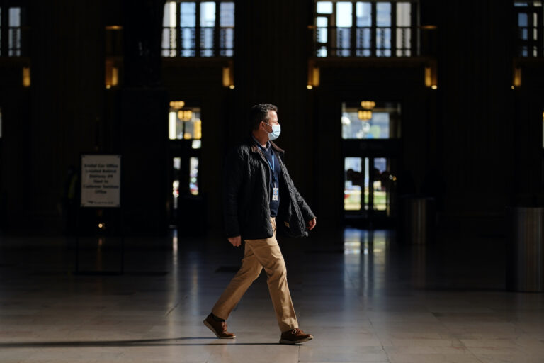 A man walks through the 30th Street Station ahead of the Thanksgiving holiday, Friday, Nov. 20, 2020, in Philadelphia. With the coronavirus surging out of control, the nation's top public health agency pleaded with Americans not to travel for Thanksgiving and not to spend the holiday with people from outside their household. (AP Photo/Matt Slocum)