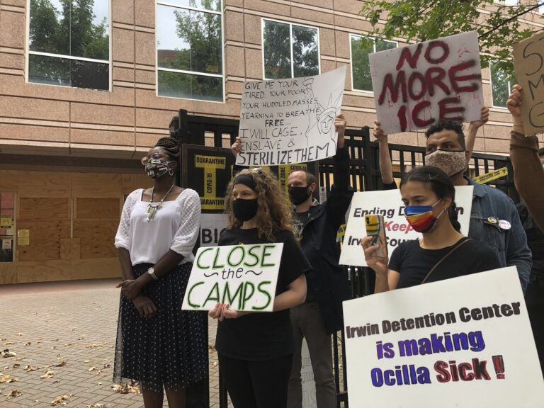 FILE - In this Sept. 15, 2020, file photo, Dawn Wooten, left, a nurse at Irwin County Detention Center in Ocilla, Georgia, speaks at a news conference in Atlanta protesting conditions at the immigration jail. The U.S. government has agreed temporarily not to deport detained immigrant women who have alleged being abused by a rural Georgia gynecologist who was seeing patients at the detention center, according to court papers filed Tuesday, Nov. 24. (AP Photo/Jeff Amy, File)