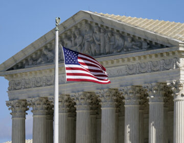 In this Nov. 2, 2020, file photo an American flag waves in front of the Supreme Court building on Capitol Hill in Washington. (AP Photo/Patrick Semansky)
