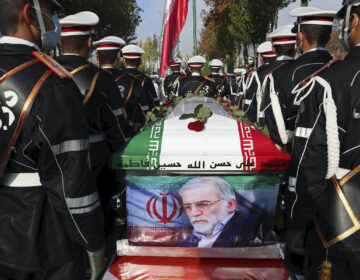 Photo released by the official website of the Iranian Defense Ministry, military personnel stand near the coffin of Mohsen Fakhrizadeh, a nuclear scientist who was killed on Friday, in a funeral ceremony in Tehran, Iran, Monday, Nov. 30, 2020. (Iranian Defense Ministry via AP)