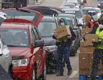 FILE PHOTO: Boxes of food are distributed by the Greater Pittsburgh Community Food Bank, at a drive thru distribution near PPG Arena in downtown Pittsburgh, Friday, April 10, 2020. (Gene J. Puskar / AP Photo)