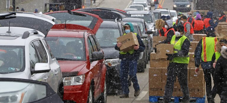 Boxes of food are distributed by the Greater Pittsburgh Community Food Bank, at a drive thru distribution