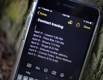 A smartphone belonging to Drew Grande, 40, of Cranston, R.I., shows notes he made for contact tracing Wednesday, April 15, 2020. Grande began keeping a log on his phone at the beginning of April. (Steven Senne / AP Photo)