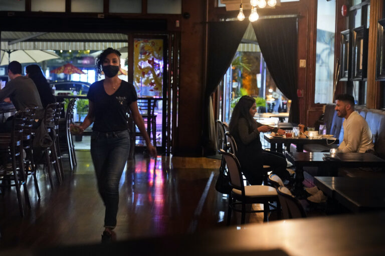 Patrons enjoy food and drink at The Brass Rail in Hoboken, N.J.