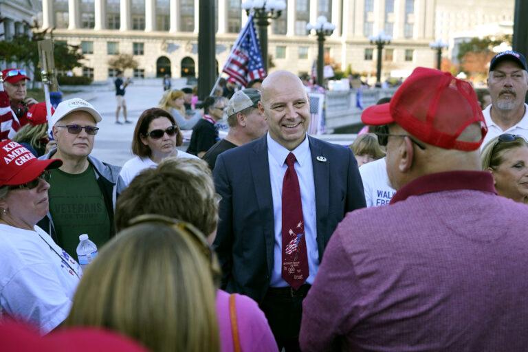 Pennsylvania state Sen. Doug Mastriano, R-Franklin, center, speaks to supporters of President Donald Trump