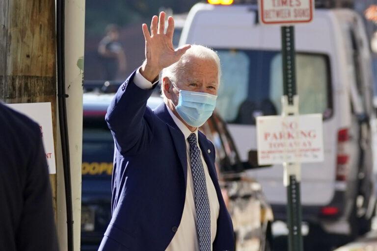 President-elect Joe Biden waves as he arrives Monday, Nov. 9, 2020, at The Queen theater