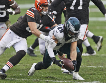 Philadelphia Eagles linebacker Alex Singleton recovers a fumble during the second half