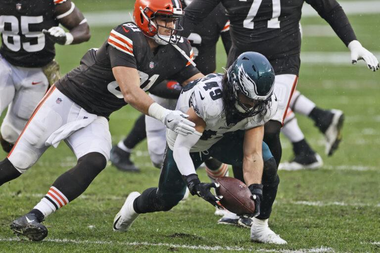 Philadelphia Eagles linebacker Alex Singleton recovers a fumble during the second half