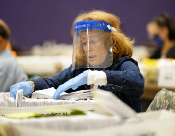 Paula Plotkin processes mail-in ballots at Bergen Community College