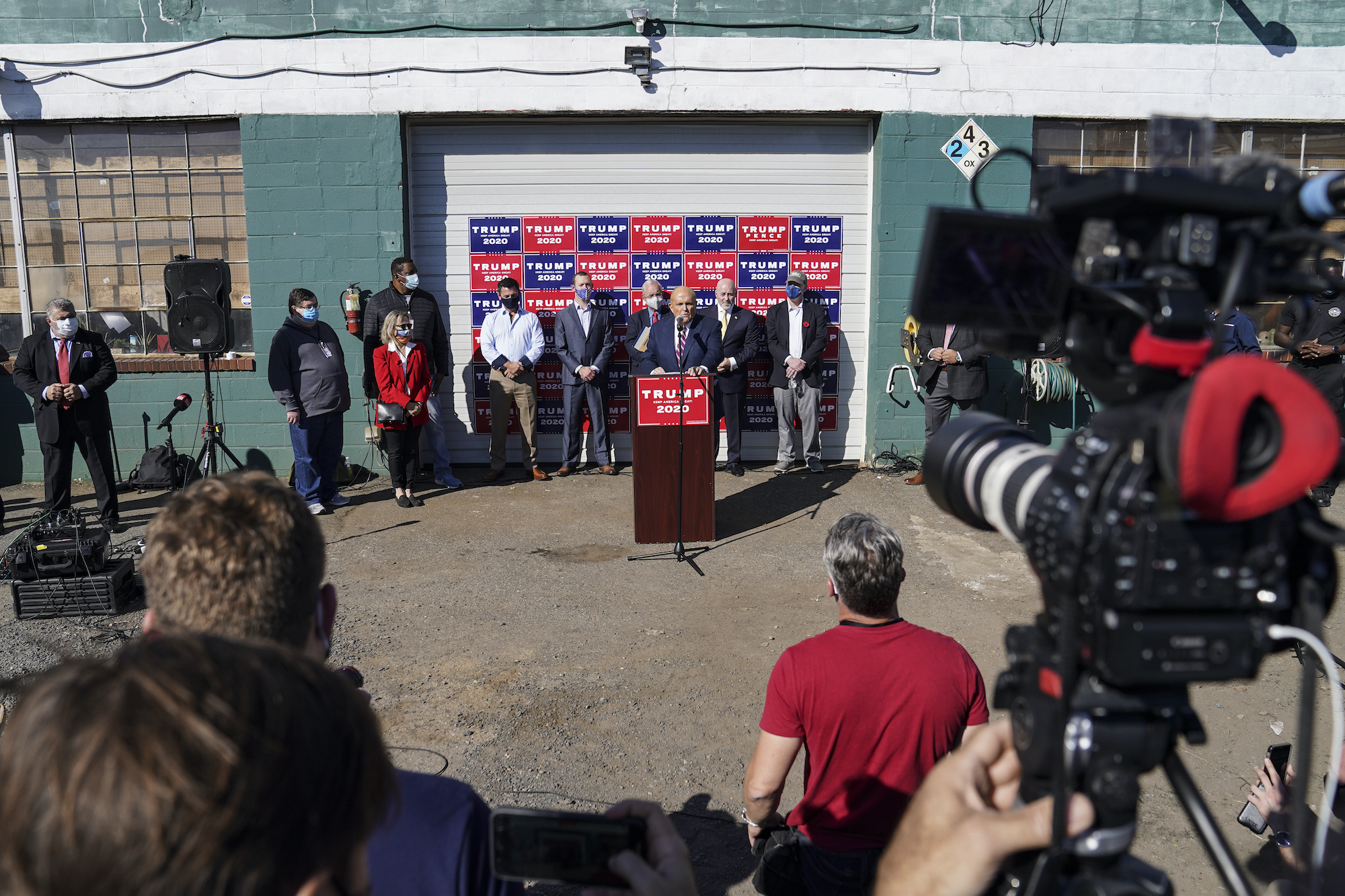 Former New York mayor Rudy Giuliani, a lawyer for President Donald Trump, speaks during a news conference at Four Seasons Total Landscaping on legal challenges to vote counting in Pennsylvania.