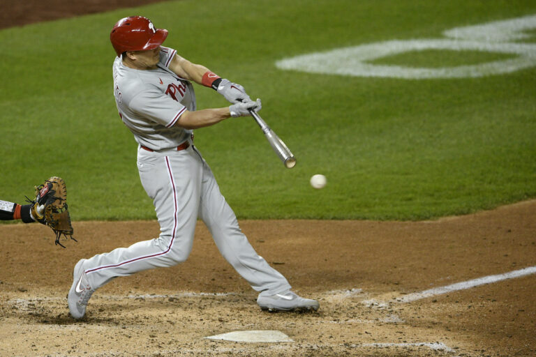 Philadelphia Phillies' J.T. Realmuto bats during the second baseball game of a doubleheader against the Washington Nationals