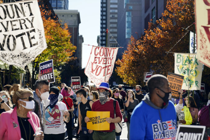 People demonstrate outside the Pennsylvania Convention Center where votes are being counted, Thursday, Nov. 5, 2020, in Philadelphia, following Tuesday's election.