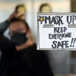 A sign reminds patrons to mask up while inside a Pennsylvania restaurant.