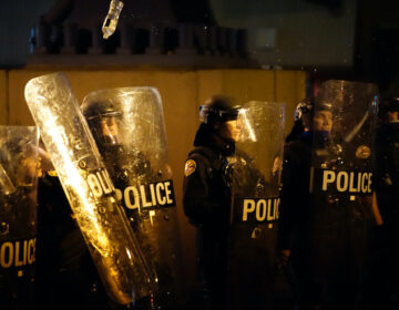 Philadelphia police face protesters following the killing of Walter Wallace Jr. in West Philadelphia.