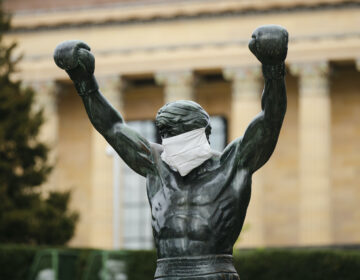 The Rocky statue is outfitted with a mock surgical face mask