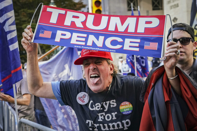 An angry supporter of President Donald Trump shouts at crowds of celebrating demonstrators after the 2020 presidential election is called for President-elect Joe Biden, Saturday, Nov. 7, 2020, in Philadelphia.