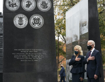 President-elect Joe Biden, and Jill Biden, stand with their hands over their hearts before placing a wreath at the Philadelphia Korean War Memorial