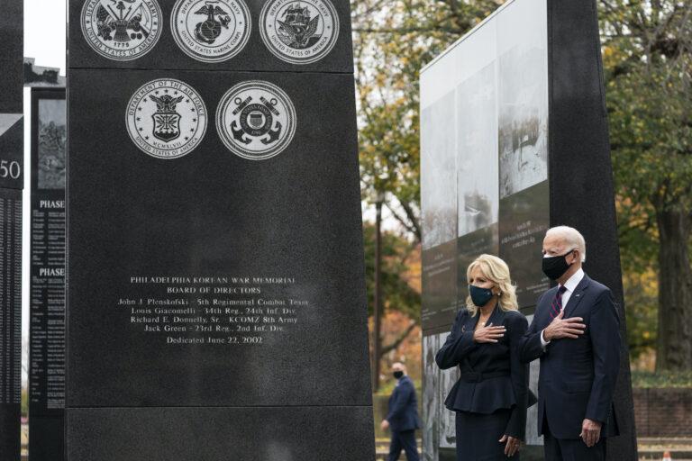 President-elect Joe Biden, and Jill Biden, stand with their hands over their hearts before placing a wreath at the Philadelphia Korean War Memorial