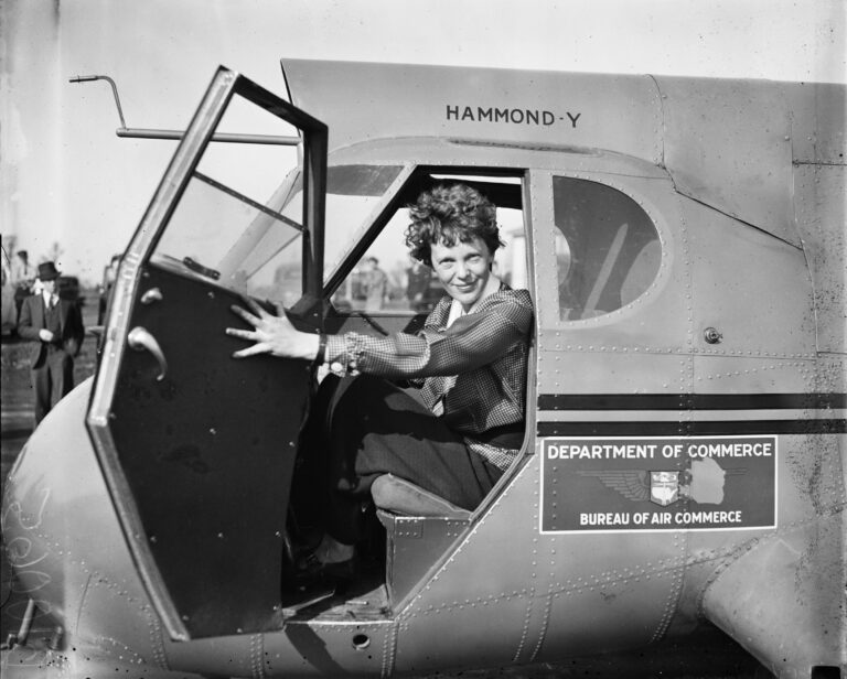 Amelia Earhart sitting in an airplane