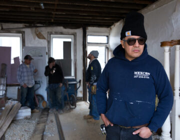 Javier (right) surveys the progress that his employees have made at a job site in South Philadelphia on Jan. 10, 2020. (Photo by Rachel Wisniewski)