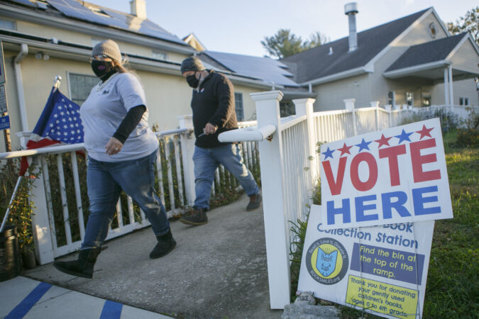Polls open at 6 A.M in Cherry Hill, NJ in the midst of the Coronavirus pandemic to vote in person, Tuesday, November 3, 2020. (Miguel Martinez for WHYY)