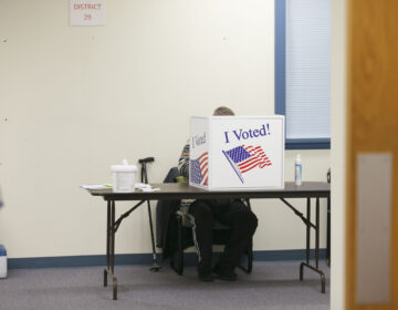 A voter fills out their ballot in Cherry Hill, N.J. on Nov. 3, 2020. (Miguel Martinez for WHYY)