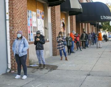 Voters practice social distance while lining up at polling place in Northern Liberties in Philadelphia on Election Day. (Miguel Martinez for WHYY)