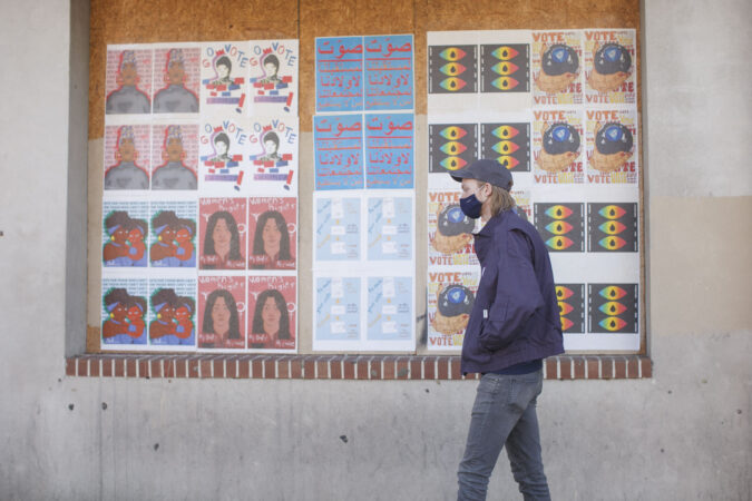A Philadelphia voter waits in line to cast his vote in person on Election Day. (Miguel Martinez for WHYY)