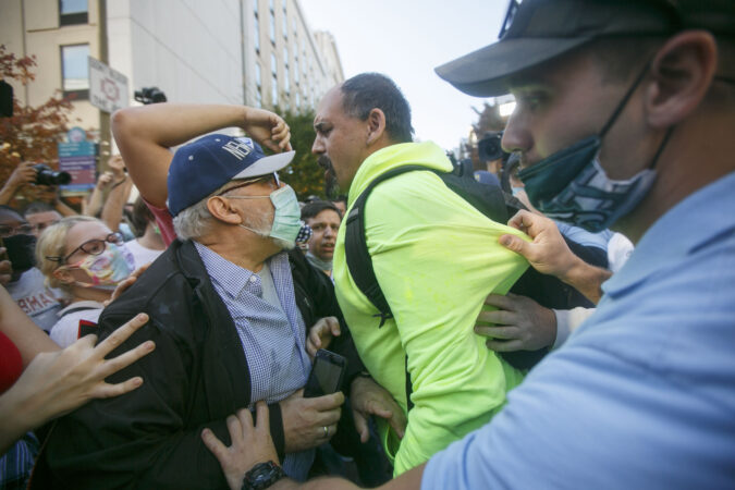 A Trump supporter clashes with Biden supporters during celebrations outside the Philadelphia Convention Center