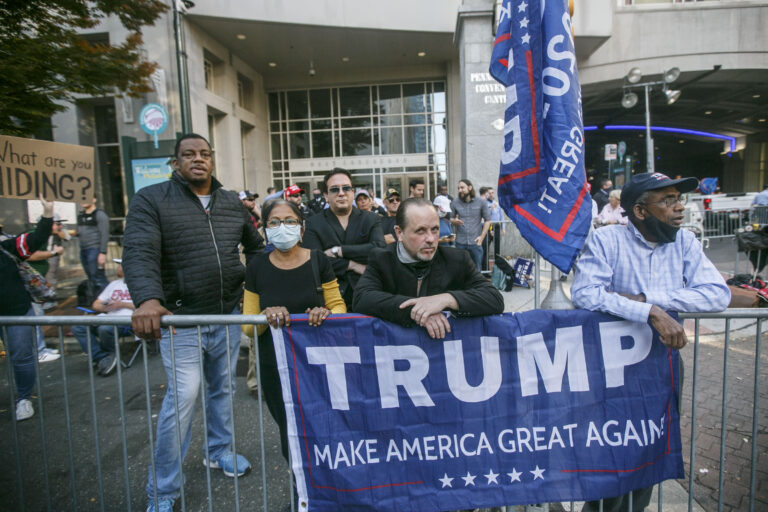 Trump supporters  outside the Convention Center after Joe Biden is projected to be the winner of the 2020 presidential election. (Miguel Martinez for WHYY)
