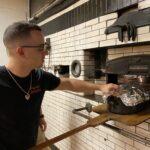Baker Joe Cacia roasts Thanksgiving turkeys for customers at Cacia's Bakery in South Philly. (Liz Tung / WHYY)