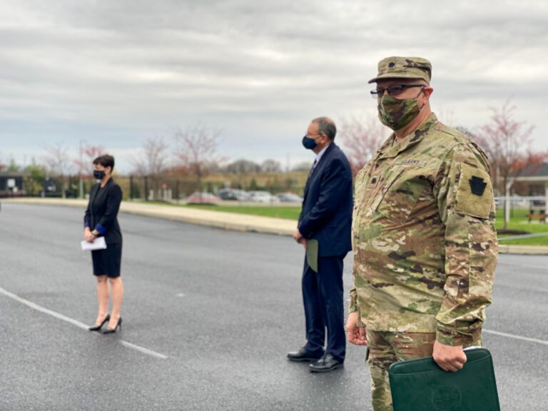 Lieutenant Col. Albert Fogle, at right, glances at the camera while attending a press conference Thur., Nov. 12, 2020. Behind him are Pennsylvania Emergency Management Agency Director David