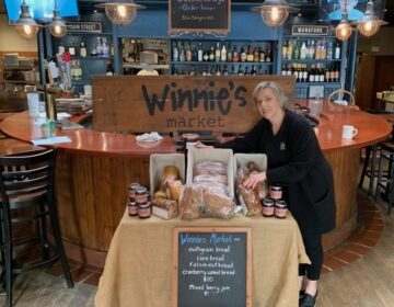 Winnie Clowry wraps Thanksgiving to-go meals at her restaurant, Winnie's Manayunk.