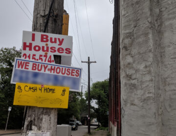 Signs from residential wholesale buyers can be found all over Philadelphia, advertising fast cash for homes. (Courtesy of Community Legal Services)
