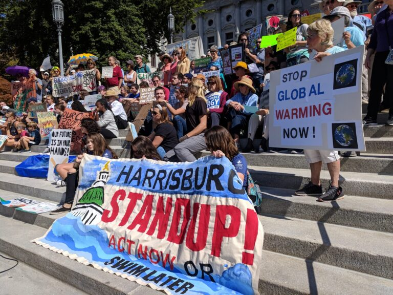 Demonstrators gather on the steps of the state capitol in Harrisburg to demand action on climate change on Friday, Sept. 20, 2019. (Rachel McDevitt/WITF)
