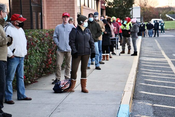 Voters line up at dawn to vote at a Garnet Valley Middle School in Glen Mills, Pa. (Emma Lee/WHYY)