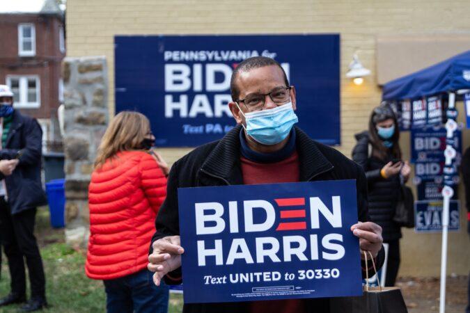 Neil Porter holds a Biden-Harris sign