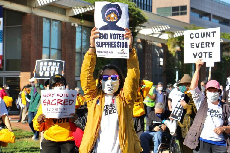 Protesters raise signs at the Count Every Vote rally on Independence Mall. (Emma Lee/WHYY)