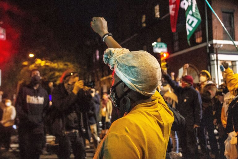 Protesters raised a fist in honor of Walter Wallace Jr. on the eve of the release of officer body cam footage of Wallace's shooting. (Kimberly Paynter/WHYY)
